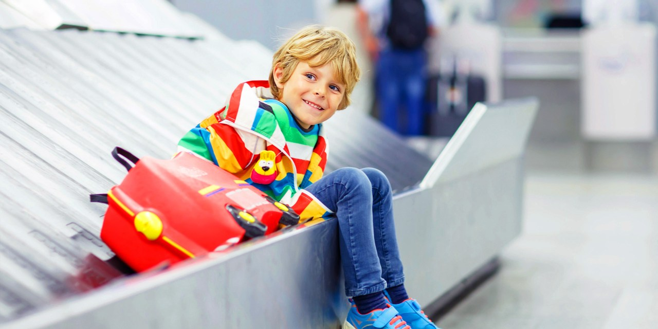 boy on baggage belt; Courtesy of Shutterstock