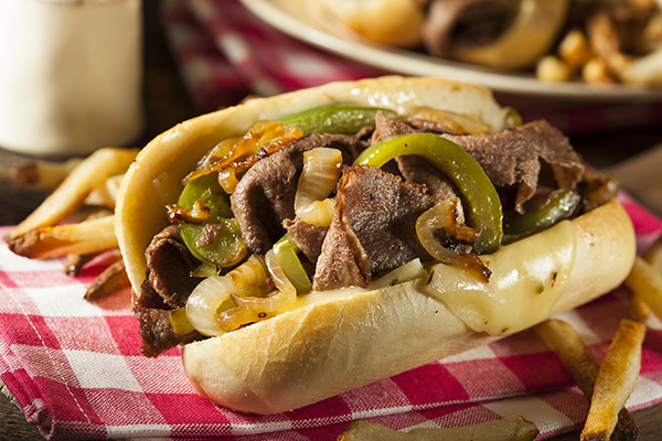 Continue your famous foods in the US tour with a classic Philly cheesesteak.
