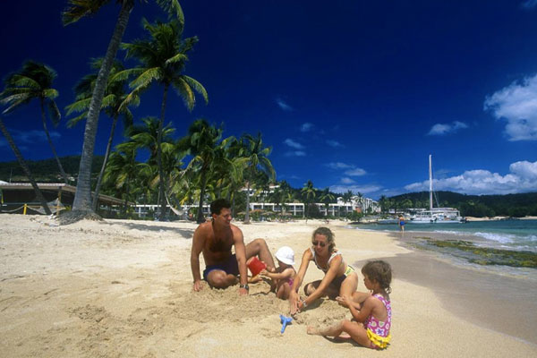 A family playing on the beach at Bolongo Bay Beach Resort in St. Thomas.