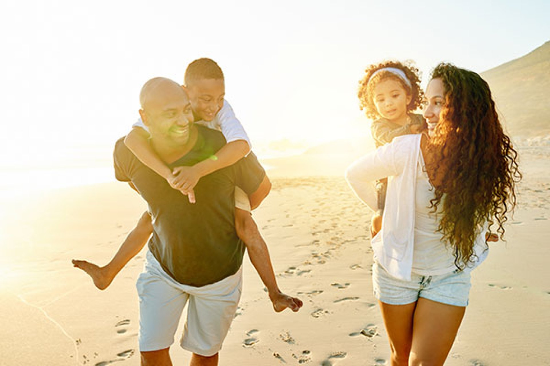 A family playing on the beach.