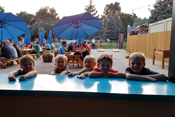 A group of kids having fun at Intersect Brewing in Fort Collins, Colorado.