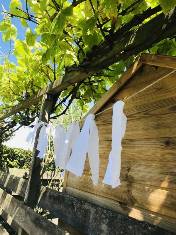Witte tuinslinger