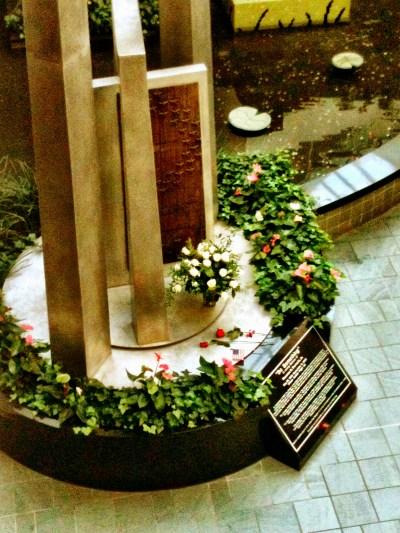 A cellphone shot from my iphone of the memorial on 9/11/12. The vase of white roses appear each year, I am not sure who from.