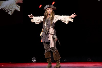 "ANAHEIM, CA - AUGUST 15:  Actor Johnny Depp,  dressed as Captain Jack Sparrow, of PIRATES OF THE CARIBBEAN: DEAD MEN TELL NO TALES took part today in ""Worlds, Galaxies, and Universes: Live Action at The Walt Disney Studios"" presentation at Disney's D23 EXPO 2015 in Anaheim, Calif.  (Photo by Jesse Grant/Getty Images for Disney) *** Local Caption *** Johnny Depp"
