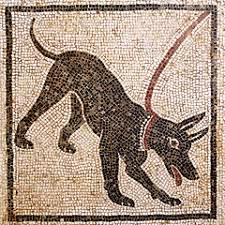 """Este mosaico indicaba en la antigua Roma que había un perro en casa. También figuraba la palabra """"CAVE CANEM"""" que advertía de su peligrosidad. Una muestra más del proceso de domesticación del perro."""