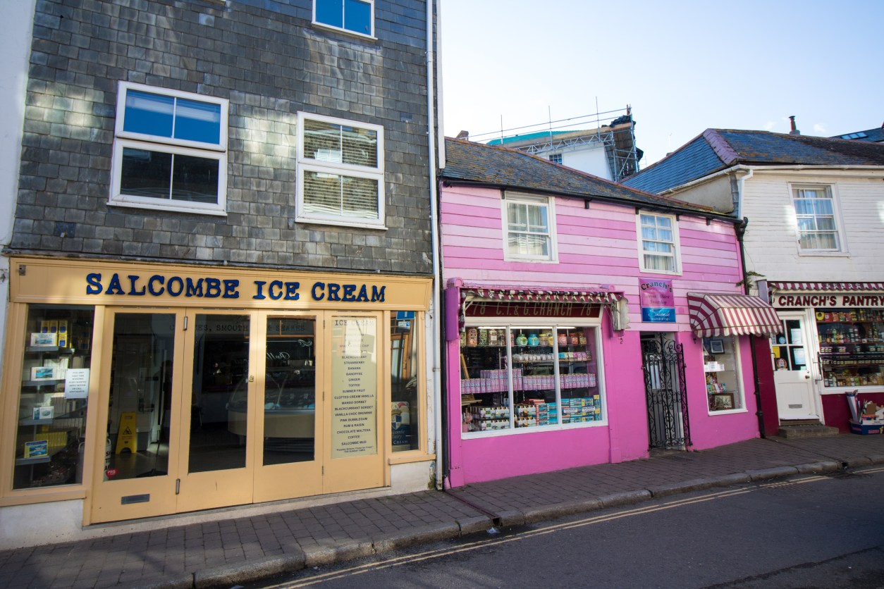 Colourful shop fronts. Salcombe Ice Cream yellow shop. Pink sweet shop. Cranch's Devon's oldest sweetshop. British street in seaside town. 17 Beautiful Places to Visit in Devon for a Great Day Out. Devon England. Devon UK. Things to do in Devon. Places to see in Devon. What to see in Devon. Things to see in Devon. What to do in Devon. Devon attractions. Devon top attractions. Devon travel blog. Devon travel guide. The English Riviera. Exeter. Plymouth. Dartmouth. Dartmoor National Park. Exmoor National Park. Salcombe. Clovelly. Totnes. Appledore. Watermouth. Croyde. Woolacombe. Dartmouth. Ilfracombe. Beer. Burgh Island. Lundy Island. Click through to read more...