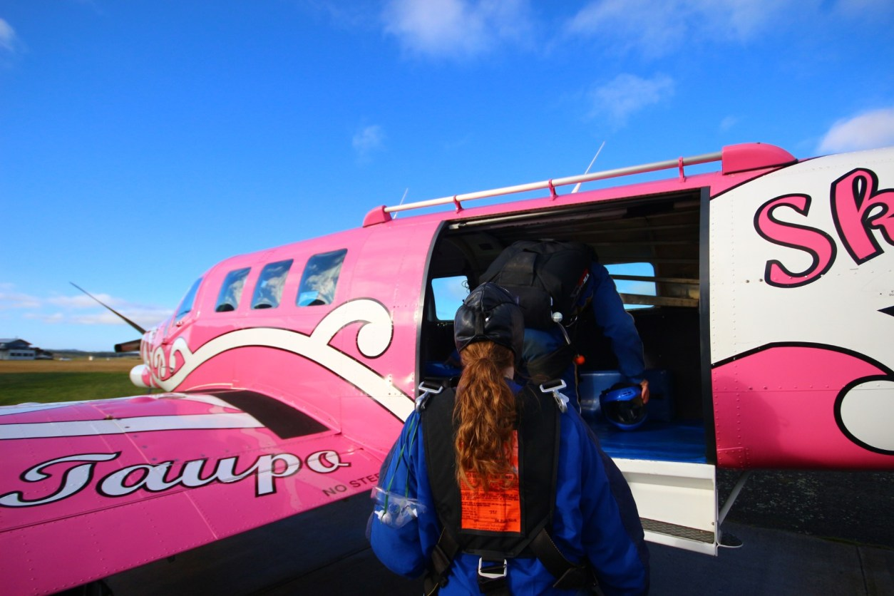 Pink airplane pink plane blue skies curly hair Skydive Taupo The Best Skydiving in New Zealand