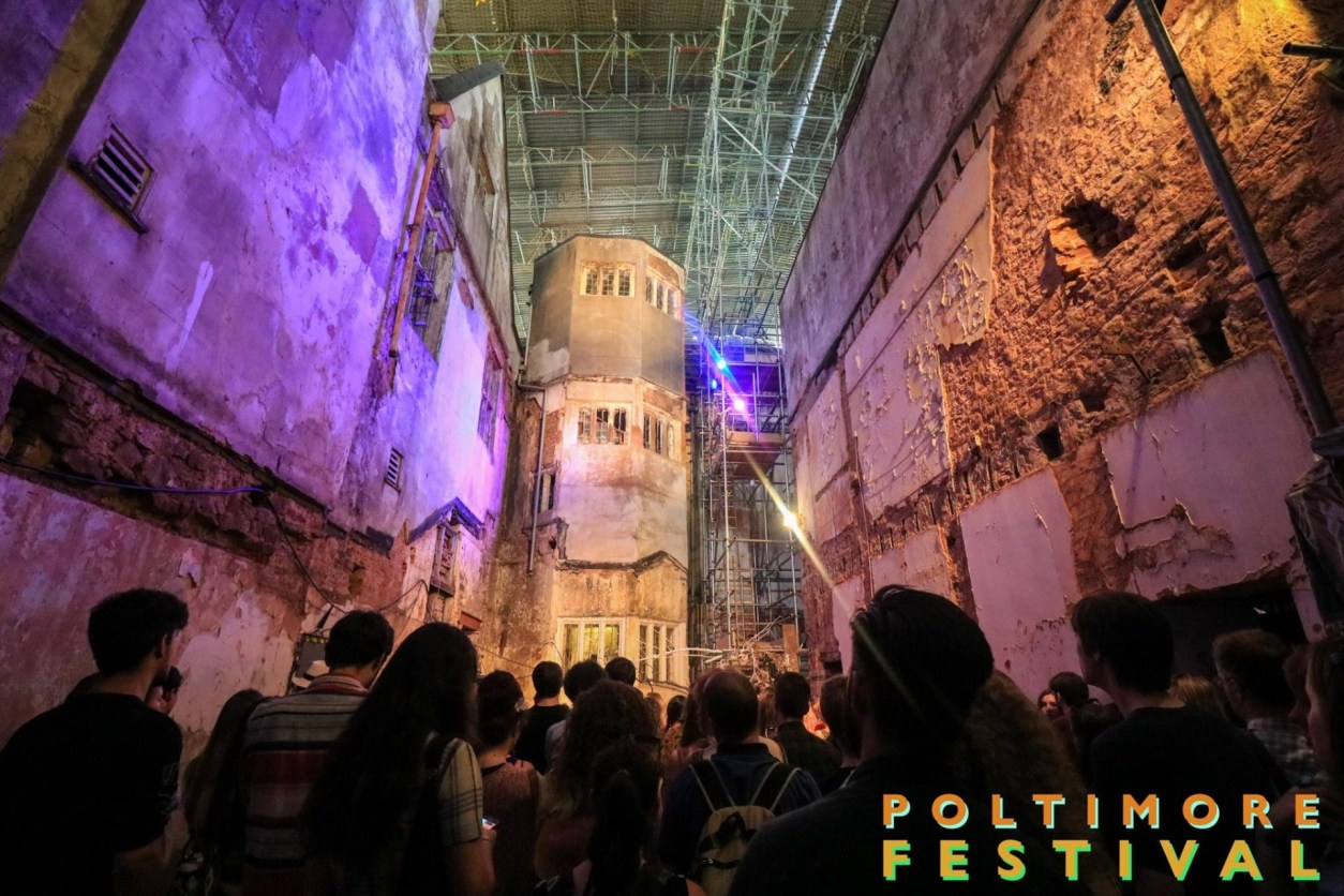 Poltimore Festival Exeter University Devon derelict building purple and orange lights crowd of people watching a gig concert live music How to Get Into Marketing with an English Degree
