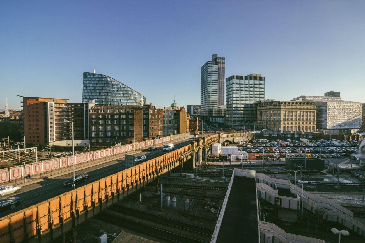 road-going-through-built-up-british-city-manchester-england-uk