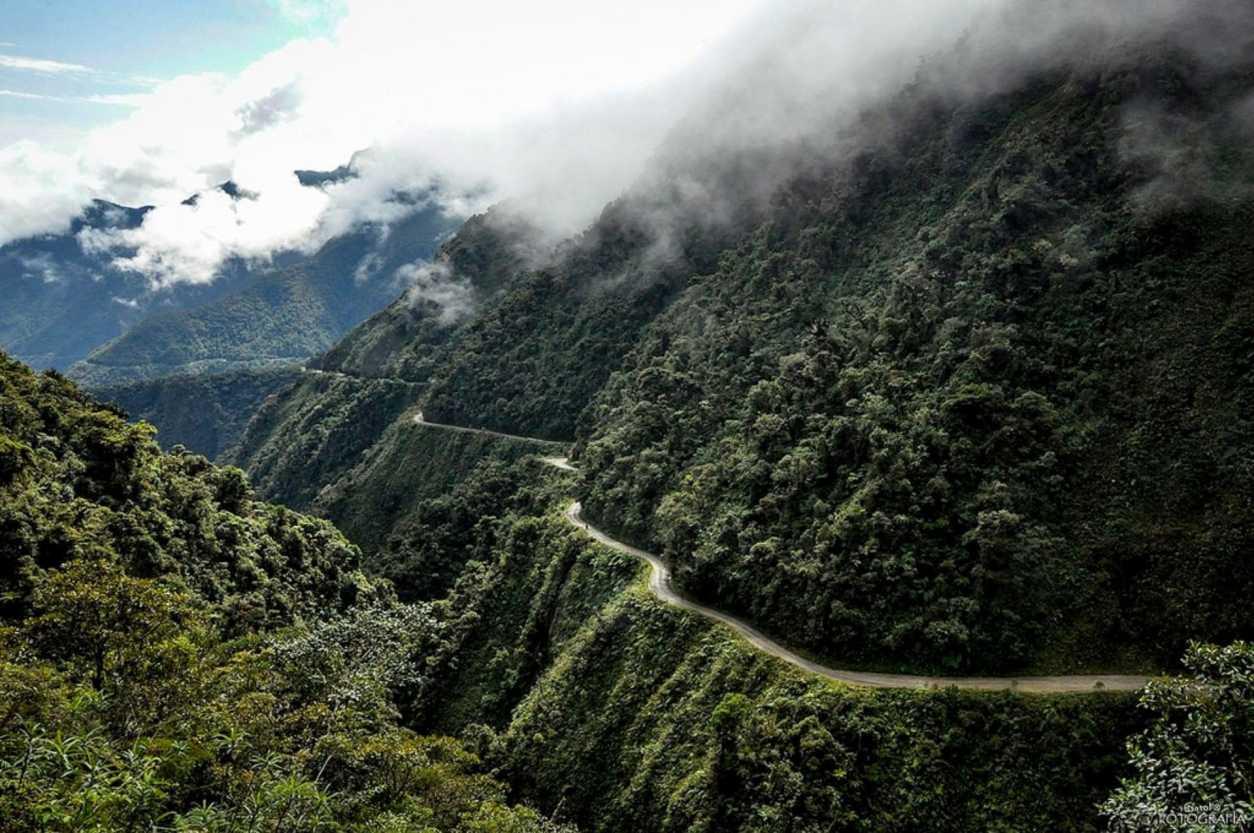 dangerous-road-running-through-mountainous-green-landscape-death-road-bolivia
