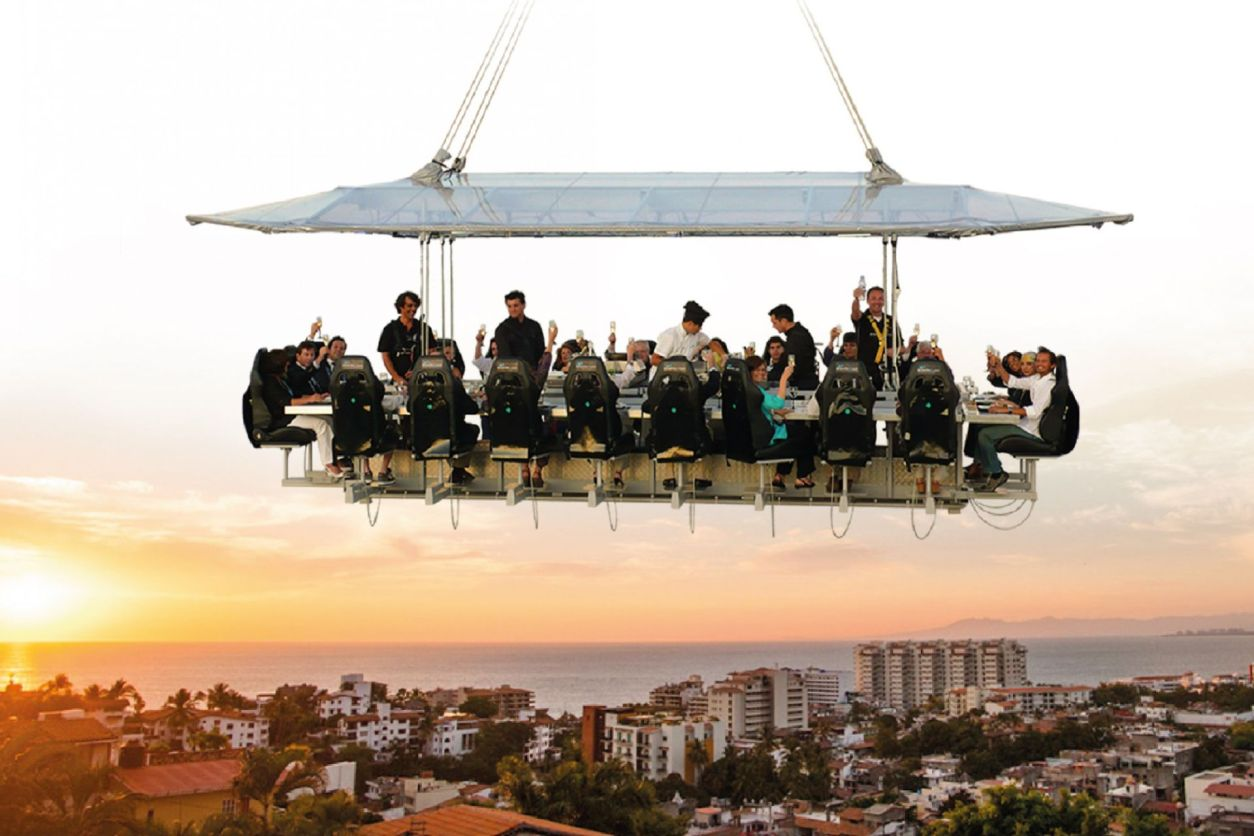 group-of-work-colleagues-sitting-at-a-table-having-dinner-in-the-sky