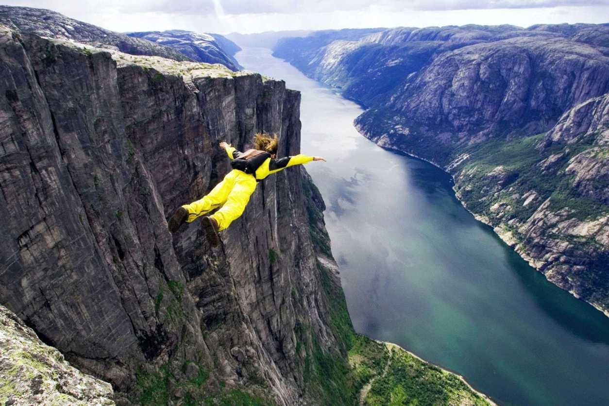 woman-base-jumping-off-cliffs-in-norway-adrenaline-junkie-bucket-list