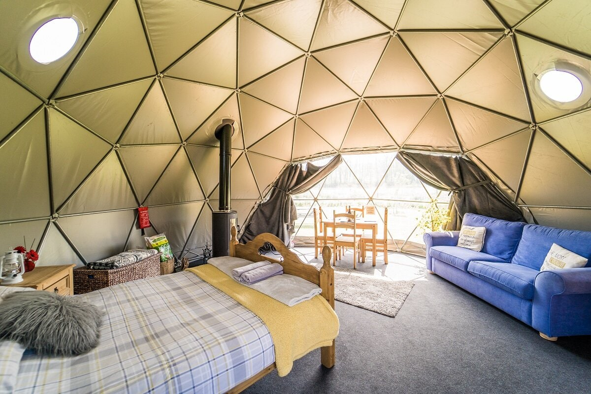 beavers-retreat-geodome-with-bed-sofa-table-and-woodburner-in-tenby-pembrokeshire-glamping-with-hot-tub-wales