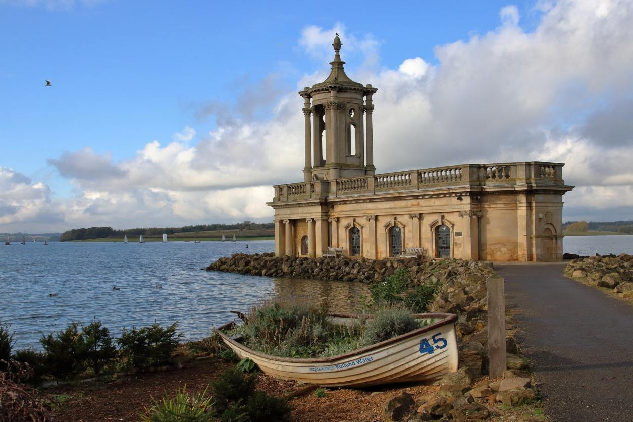 boat-by-water-and-building-by-rutland-water-reservoir-in-oakham
