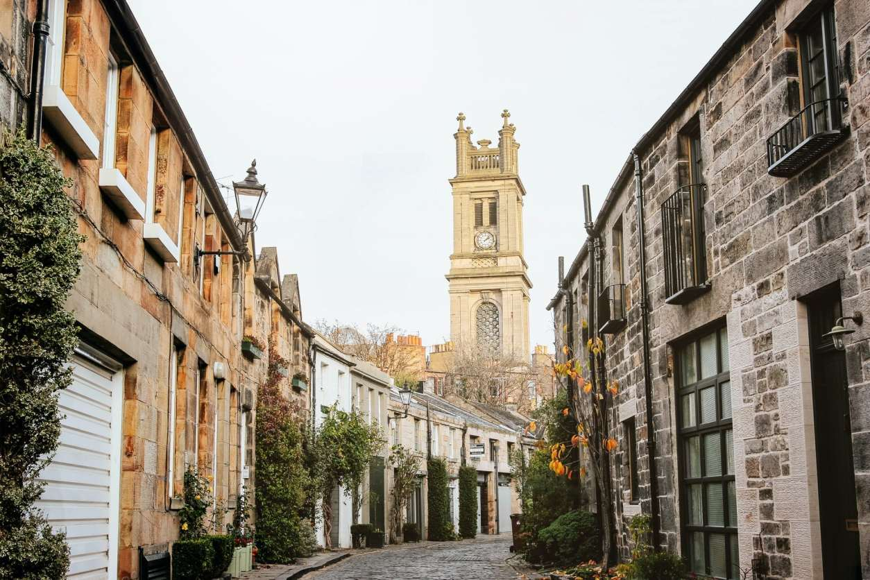 cute-lane-with-cobbled-floor-with-short-houses-on-either-side-leading-up-to-picturesque-tower-circus-lane-best-uk-city-breaks-for-couples