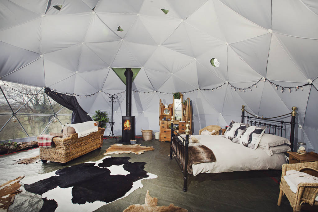 inside-a-geodome-glamping-site-with-sofa-double-bed-and-wood-burner-argoed-barns-brecon-powys