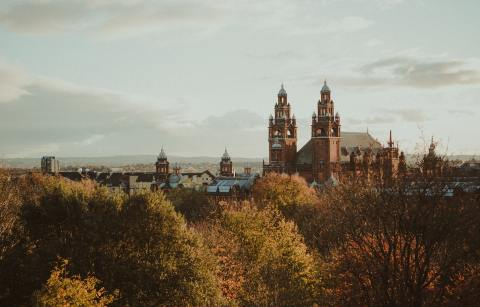 old-historic-building-in-city-poking-over-trees-in-autumn-2-days-in-glasgow