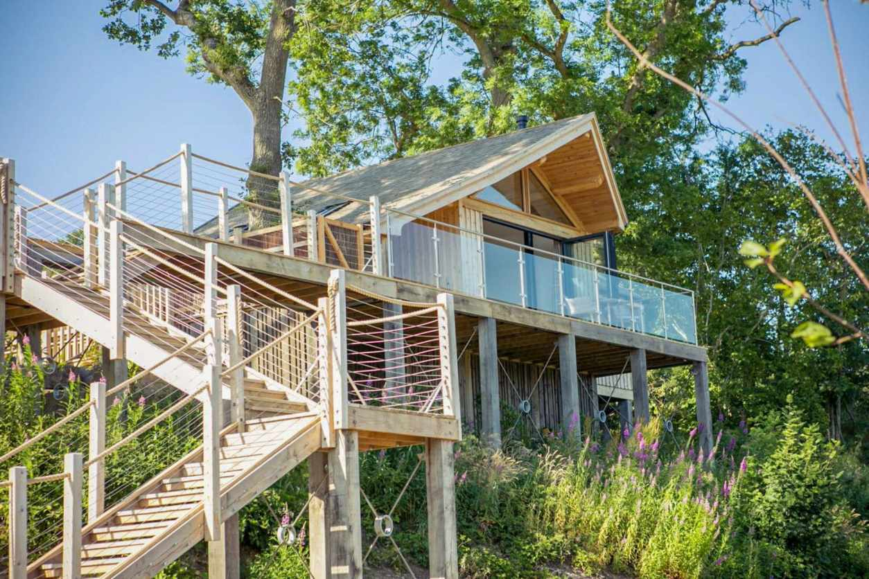 steps-leading-up-to-beach-inspired-treehouse-found-amongst-trees-oaklands-treehouse-welshpool-powys-wales-glamping-with-hot-tub-wales