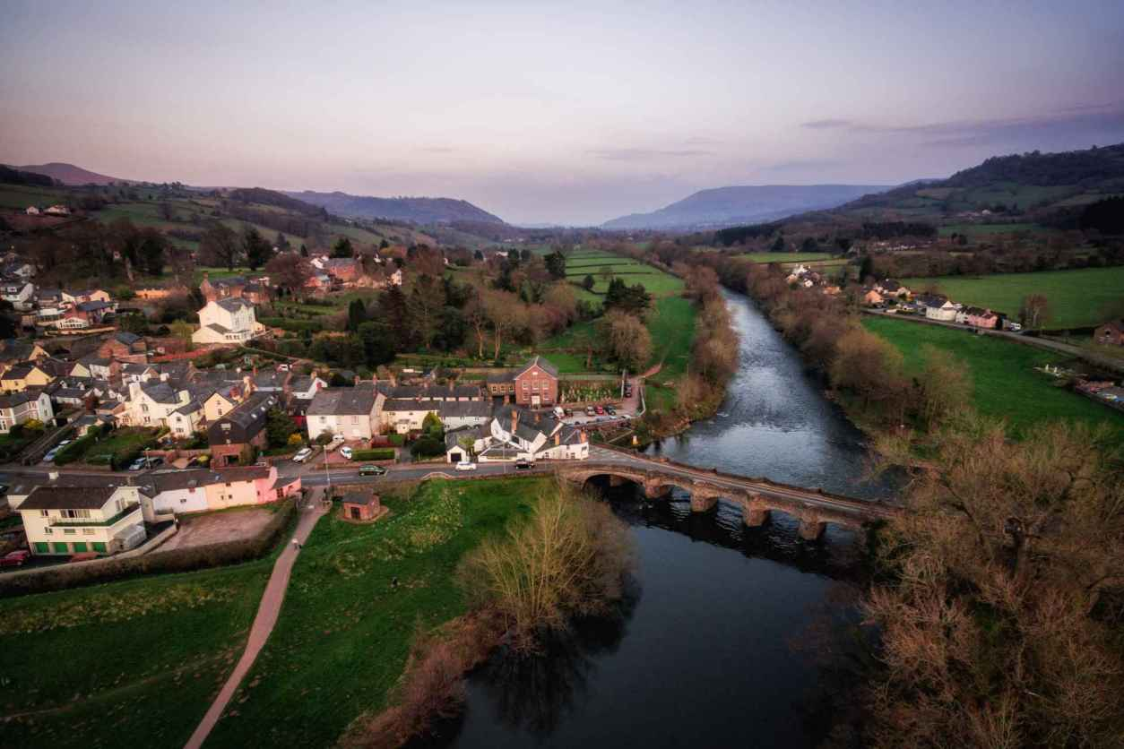 an-aerial-view-of-crickhowell-and-the-river-usk-at-sunset-days-out-in-south-wales