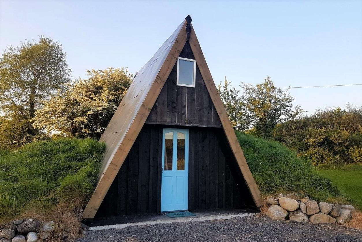 brown-and-black-a-framed-cabin-with-blue-door