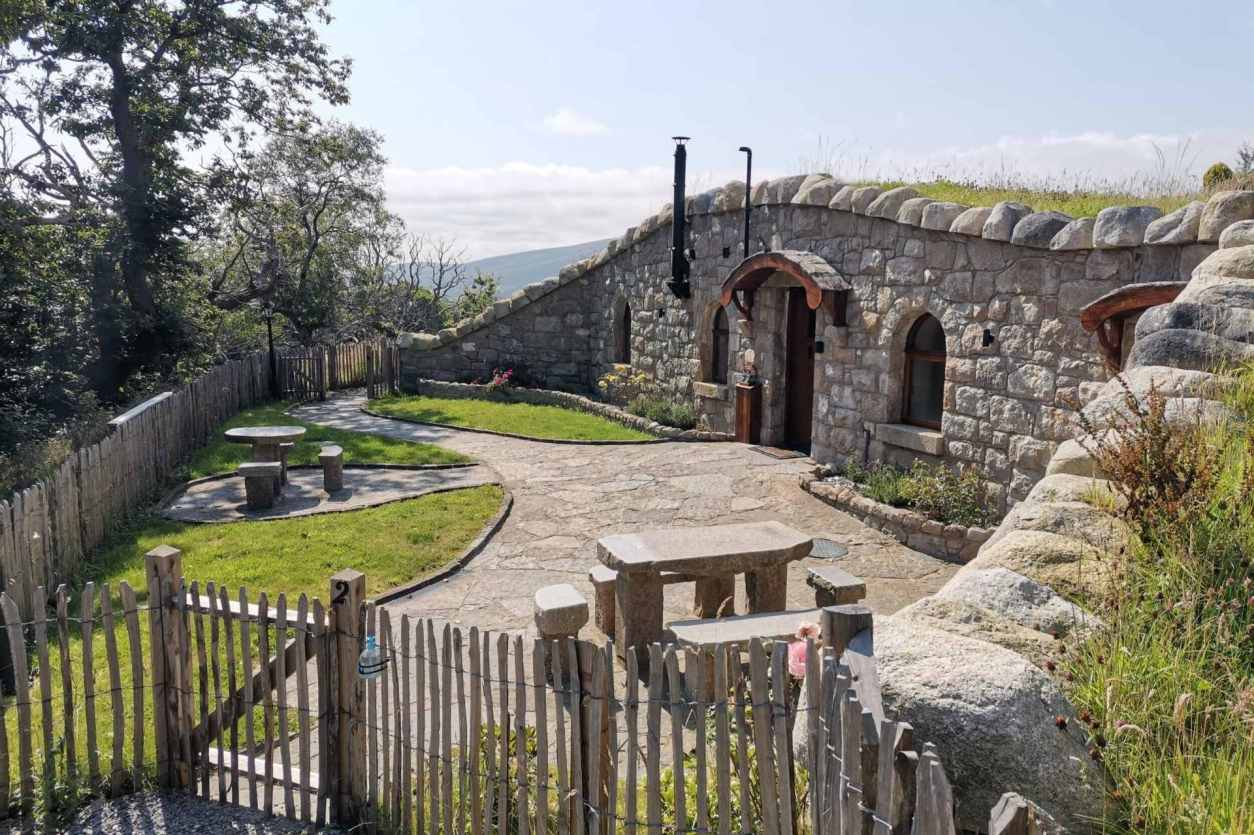 fairy-river-cottage-hobbit-hole-with-grass-roof-in-mourne