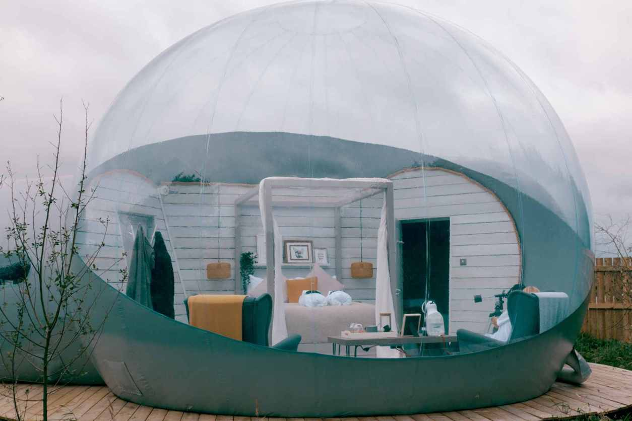 foxborough-bubble-den-on-decking-with-four-poster-bed-glamping-northern-ireland