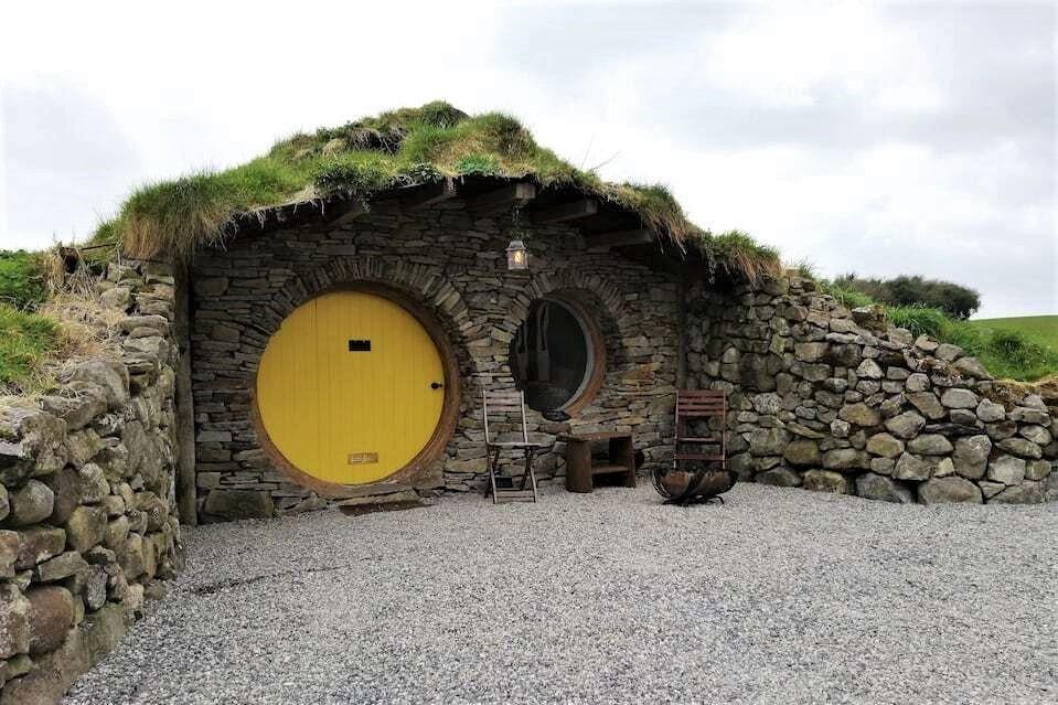 hobbit-hole-with-round-yellow-door-at-mayo-glamping-hobbit-village