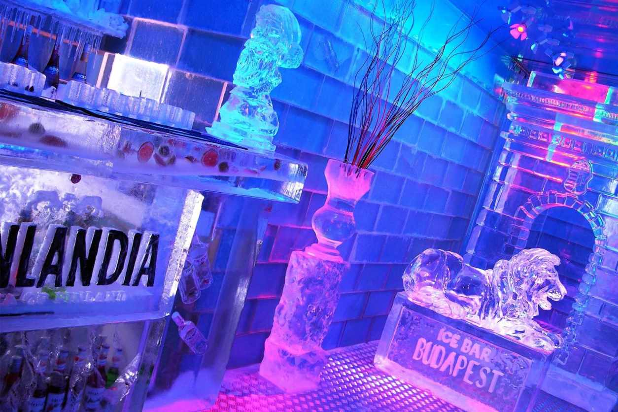 interior-of-bar-made-of-ice-lit-up-in-purple-and-blue-icebar-budapest