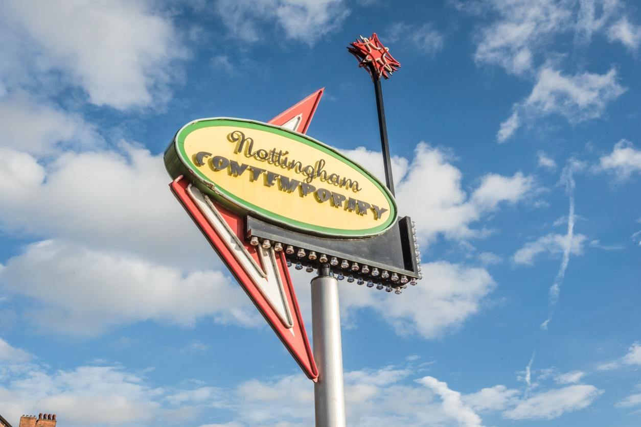 nottingham-contemporary-art-gallery-retro-american-sign-against-blue-sky-with-clouds