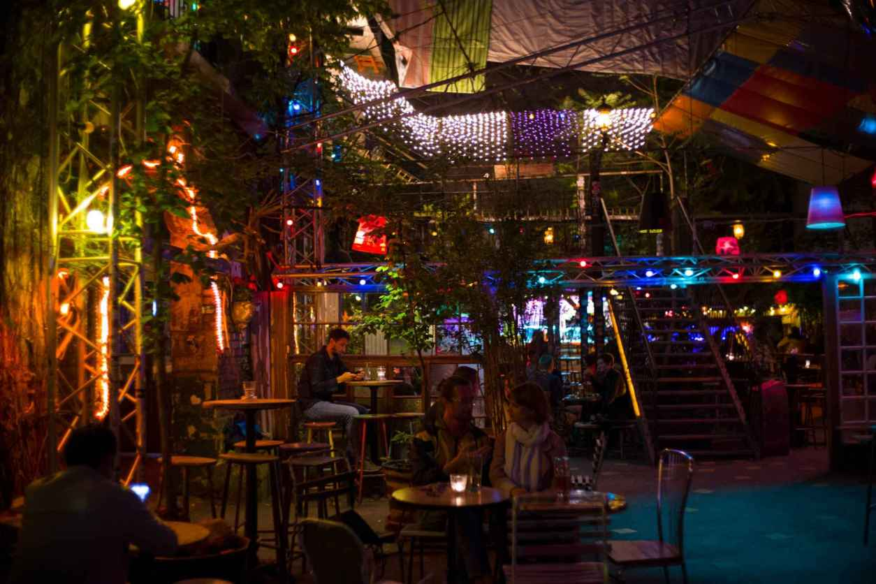people-sat-around-drinking-in-dark-quirky-indie-bar-szimpla-kert-4-days-in-budapest-itinerary