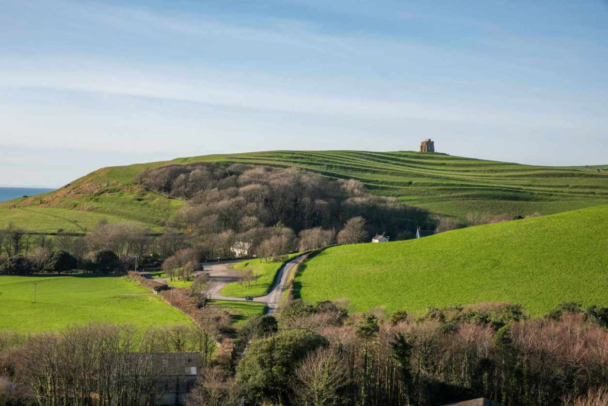 view-over-green-fields-towards-st-catherines-chapel-near-abbotsbury