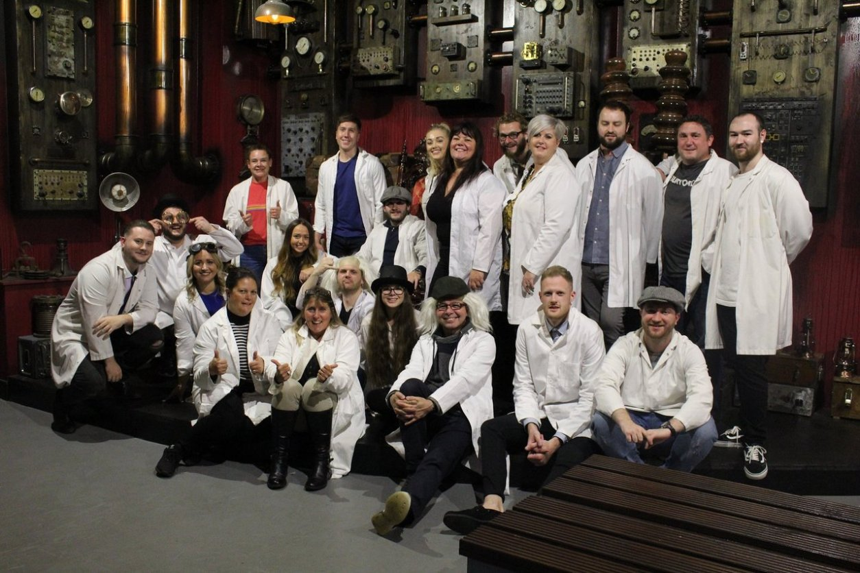 big-group-of-friends-in-white-lab-coats-at-locked-in-a-room-escape-rooms-southampton