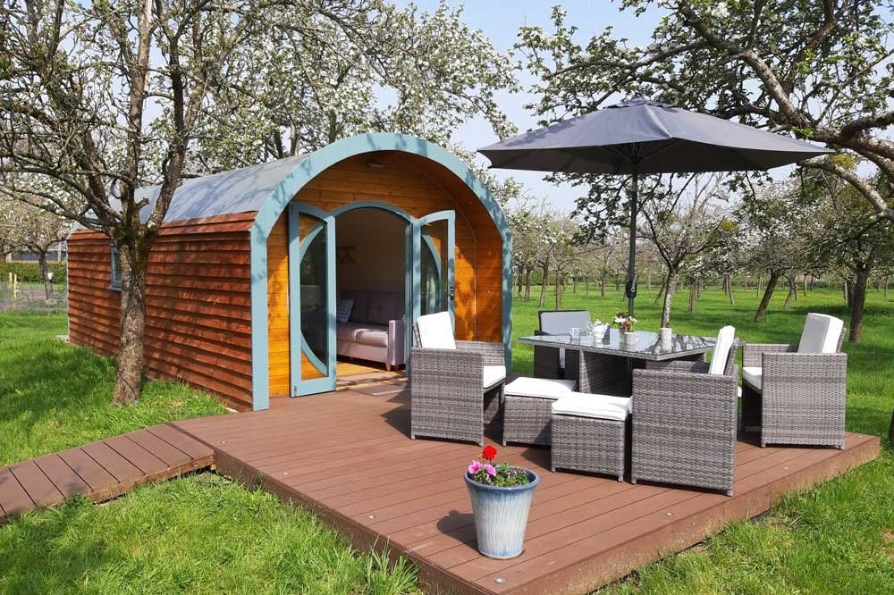 blue-and-wooden-camping-pod-on-decking-at-orchard-farm-somerset-glamping