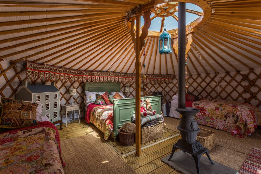 bright-and-colourful-greedy-gander-yurt-with-double-bed-and-two-single-beds