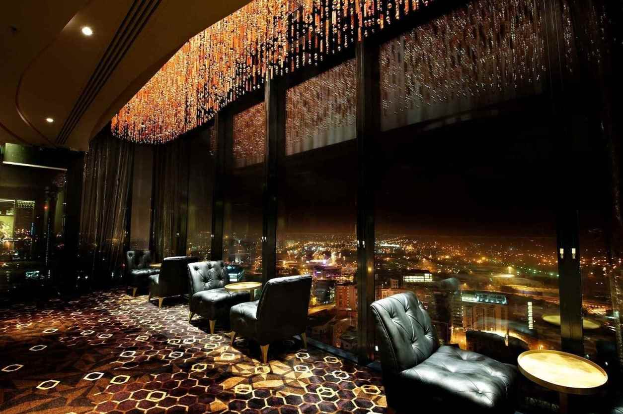 cloud-23-rooftop-bar-overlooking-city-lit-up-at-night