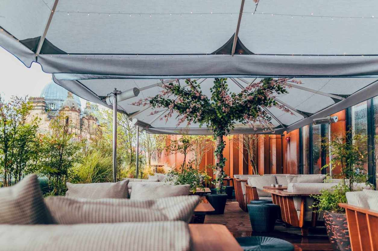 comfy-seats-and-tables-on-restaurant-rooftop-overlooking-city-issho-bottomless-brunch-leeds