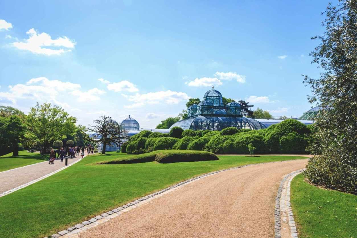 grass-field-and-path-in-laeken-park-leading-towards-the-royal-greenhouses-2-days-in-brussels-itinerary