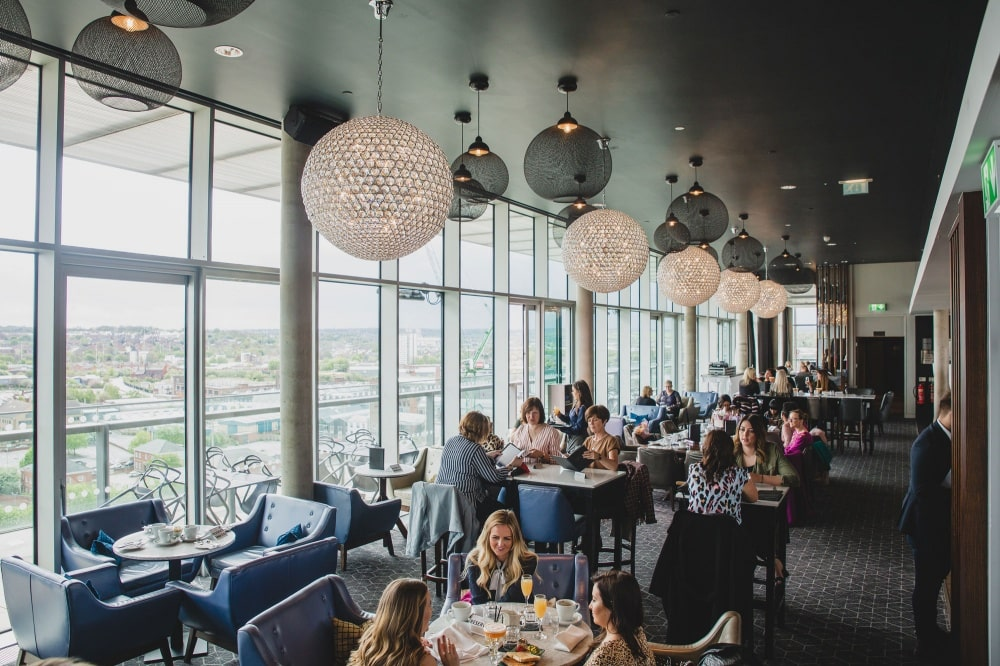 groups-of-friends-sitting-at-tables-in-sky-lounge-restaurant