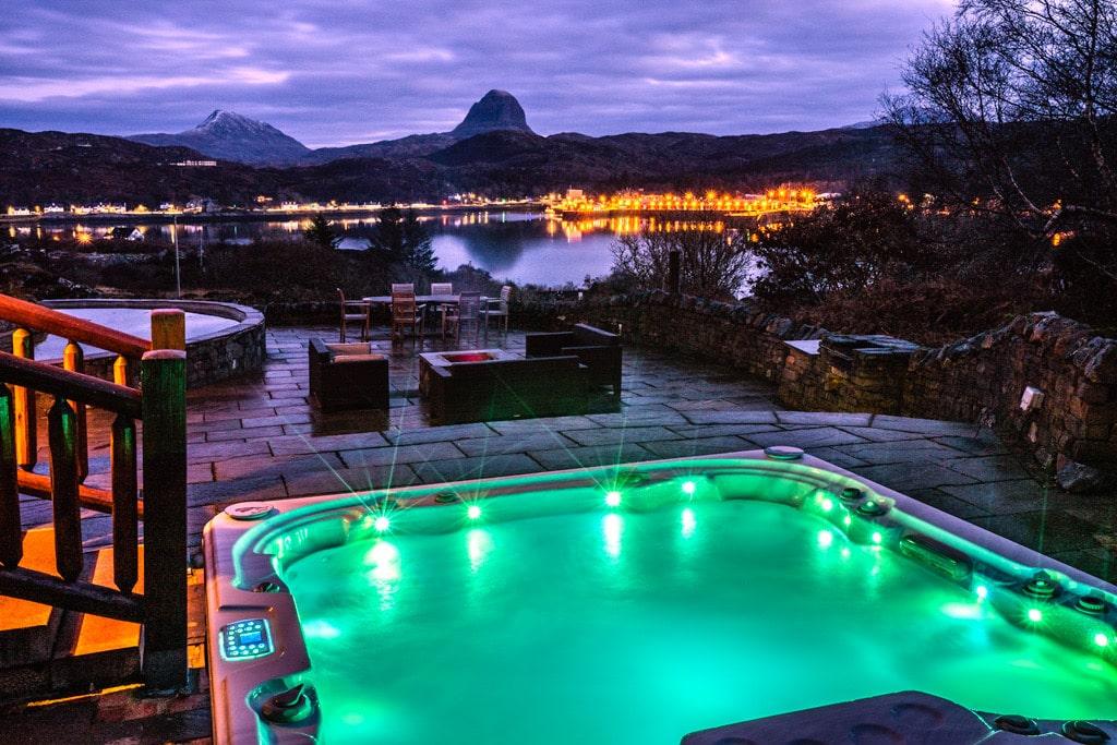 hot-tub-on-waterloo-lodge-patio-at-night-overlooking-lake