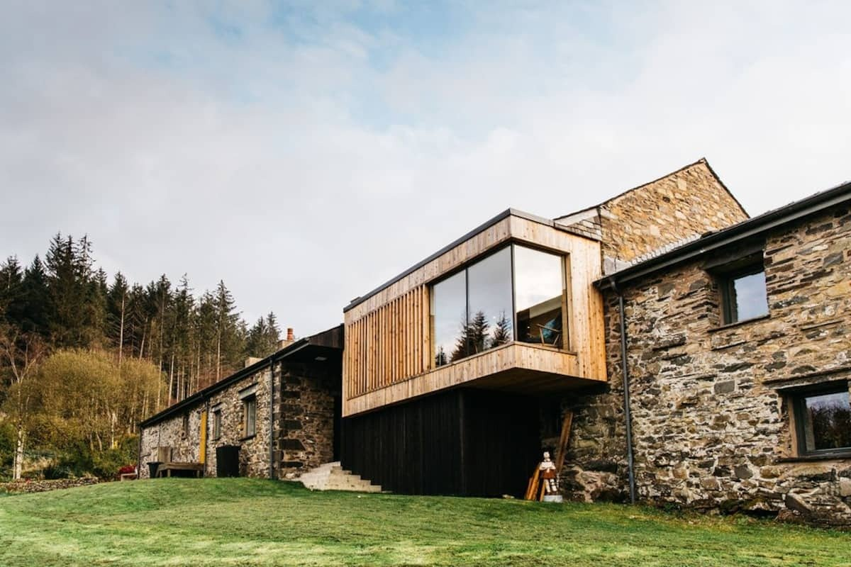 large-barn-on-hillside-with-large-floor-to-ceiling-windows-airbnbs-lake-district