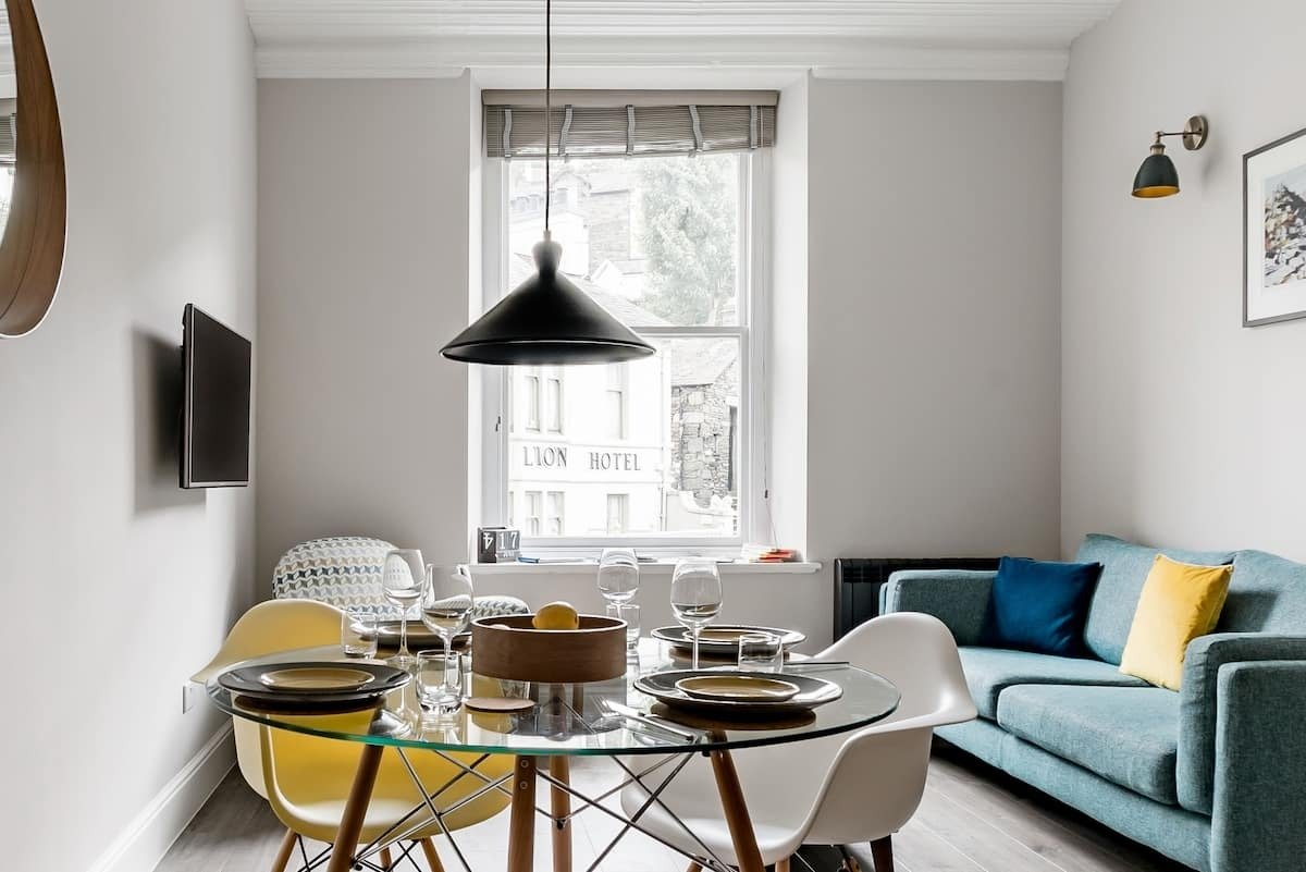 modern-table-and-chairs-and-sofa-in-midland-bank-chambers-flat-in-ambleside