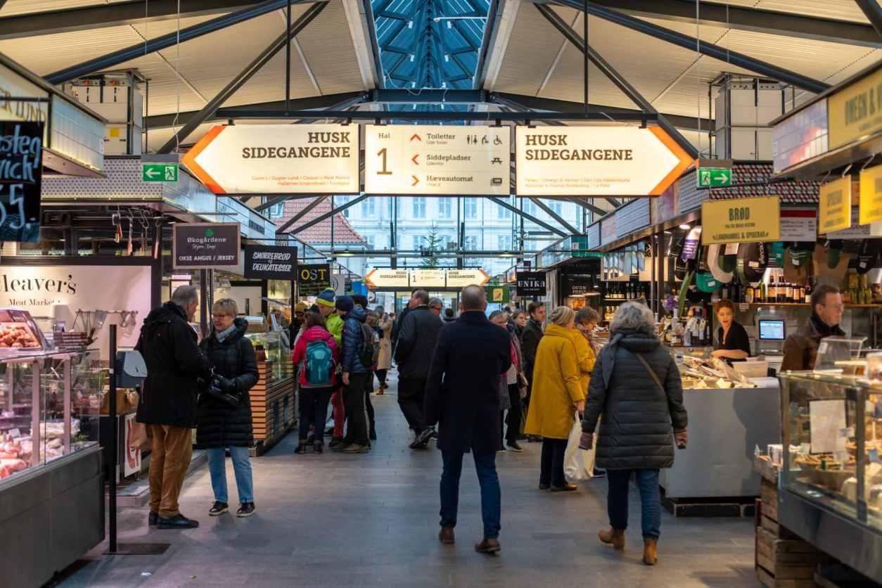 people-walking-around-torvehallerne-market-hall-food-stalls