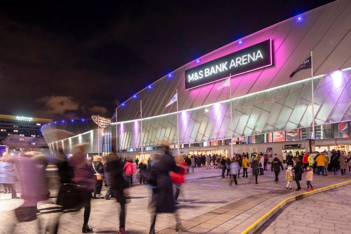 people-walking-towards-m-and-s-bank-arena-at-night