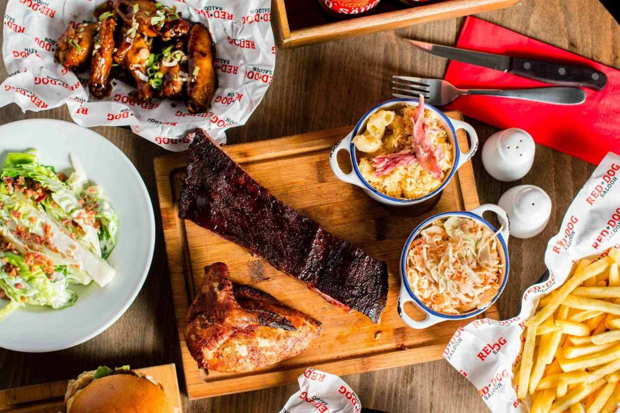 plates-of-food-on-restaurant-table-at-red-dog-saloon