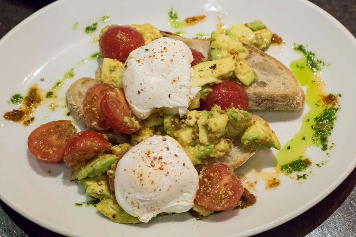 poached-egg-avocado-and-tomatoes-on-sourdough-toast-at-marcos-kitchen