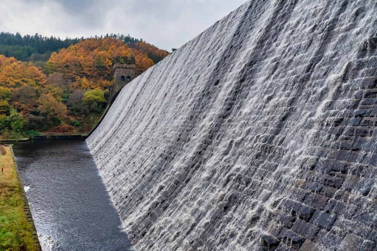 view-of-water-streaming-down-derwent-dam-from-side-in-autumn-day-trips-from-derby