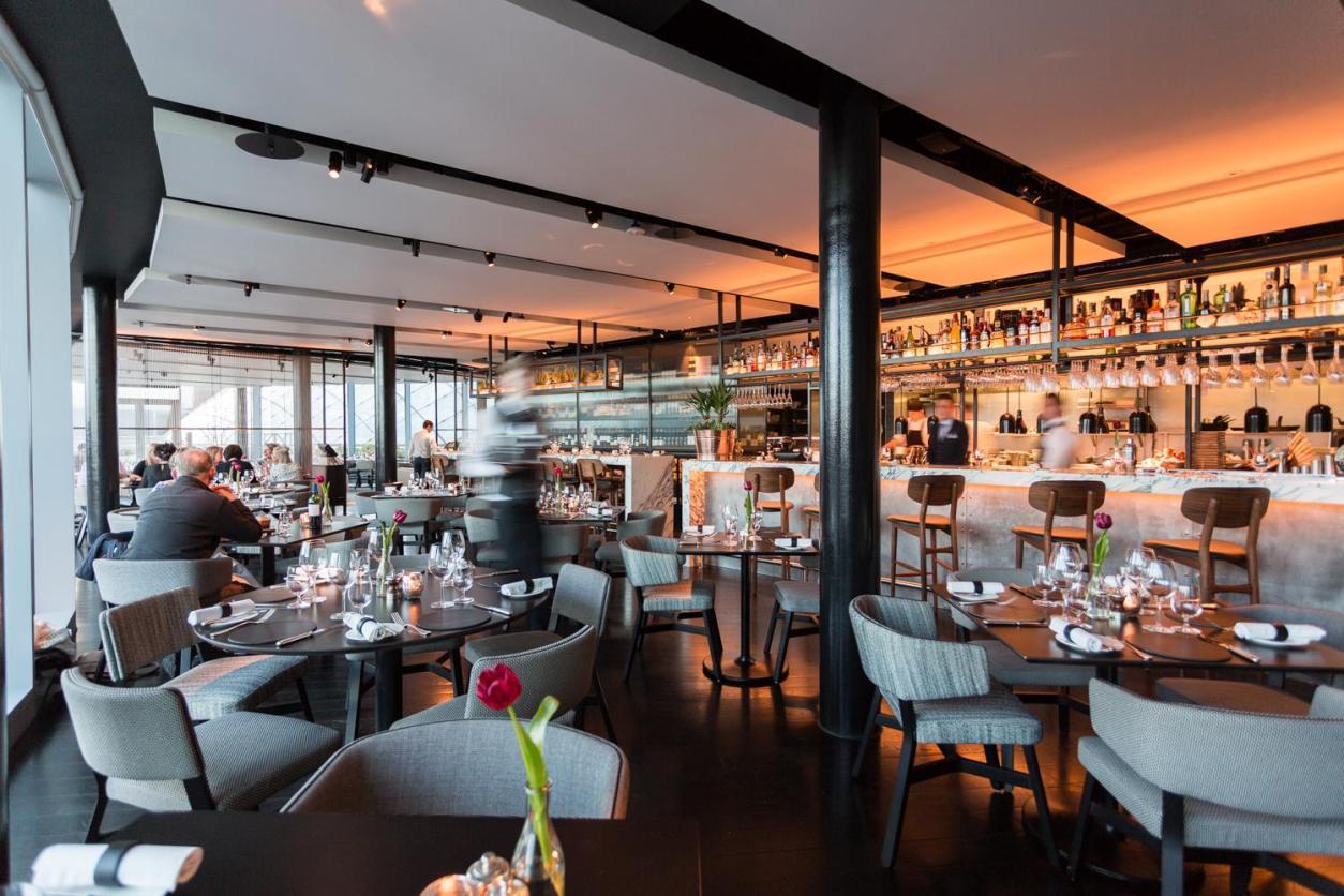 waiter-walking-around-modern-fancy-bar-and-restaurant-crafthouse