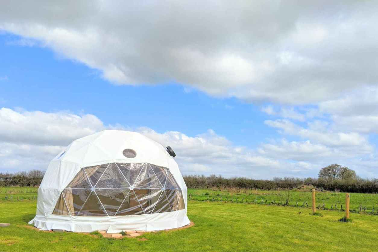 white-geodome-in-field-at-tractors-and-cream