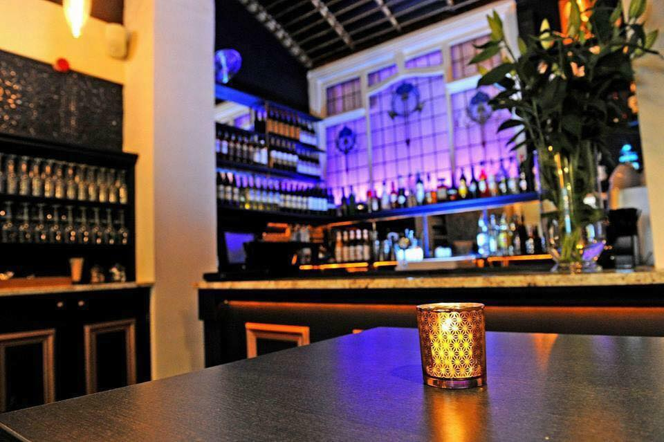 candle-on-table-in-front-of-rox-bar-at-night