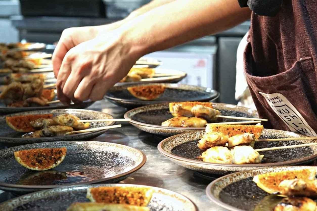 chef-dishing-up-plates-of-food-at-kushi-ya-japanese-grill-vegan-restaurants-nottingham